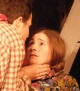 Jake (Chris Neville-Smith) grabbing Flora's neck. What a nice guy.
