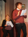 Clem (James Tynan) reads his work. Vivvi (Kayleigh Knox) hasn't a clue what's going on.