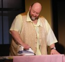 Ted (Colin Clark) does the ironing.