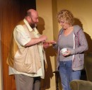 Ted (Colin Clark) gives May (Lesley Anderson) her pills.