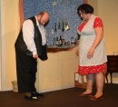 Ted (Colin Clark) shows a young Sylvia (Kayliegh Knox) the vomit her husband left on his slipper